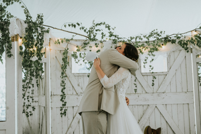 bride and groom hugging at backyard ceremony