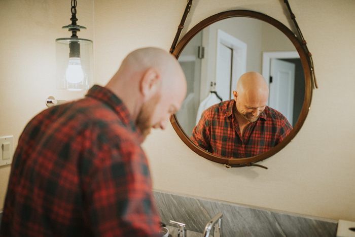creative groom getting ready pictures. groom shaving beard