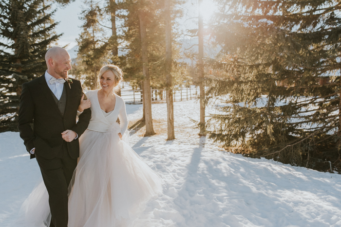 Fairmont Jasper Winter Wedding. Bride and Groom winter portraits in snow.