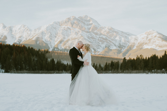 Fairmont Jasper Winter Wedding. Wedding pictures on Patricia Lake in Jasper.