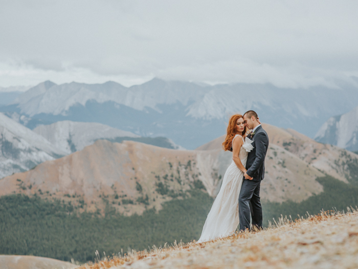 Helicopter Elopement Wedding Banff. Mountain top elopement. Bride and groom eloping on top of a mountain in Banff.