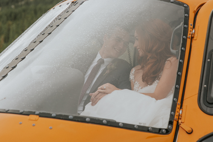 Helicopter Elopement Wedding Banff. Bride and Groom sitting in Helicopter