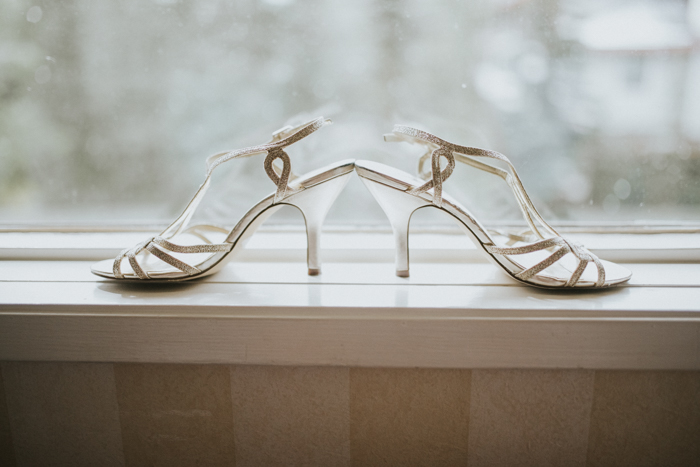 brides shoes with mountain view