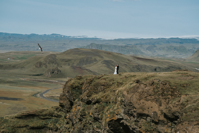 bride and groom on mountain top in iceland