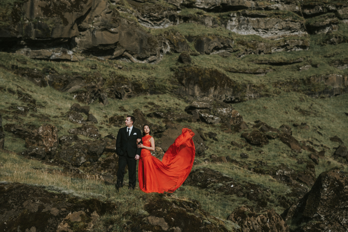 bride with red dress in iceland.