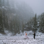 Winter Wedding with bride walking through the stone in the mountains