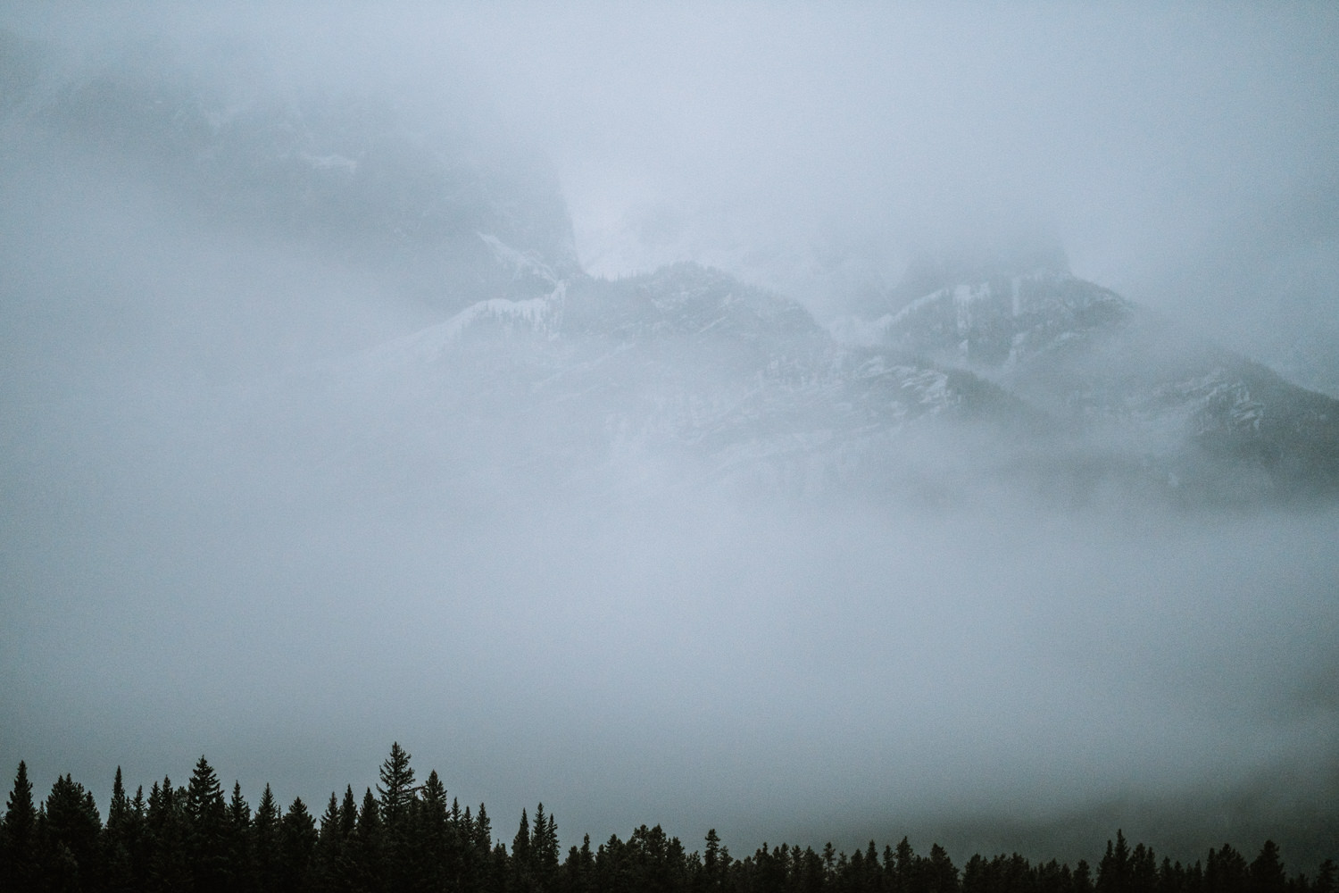 Landscape photo of mountains covered in clouds