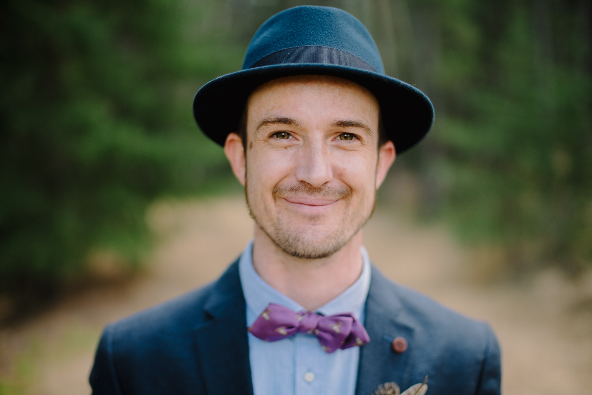 Groom wearing bow tie and hat