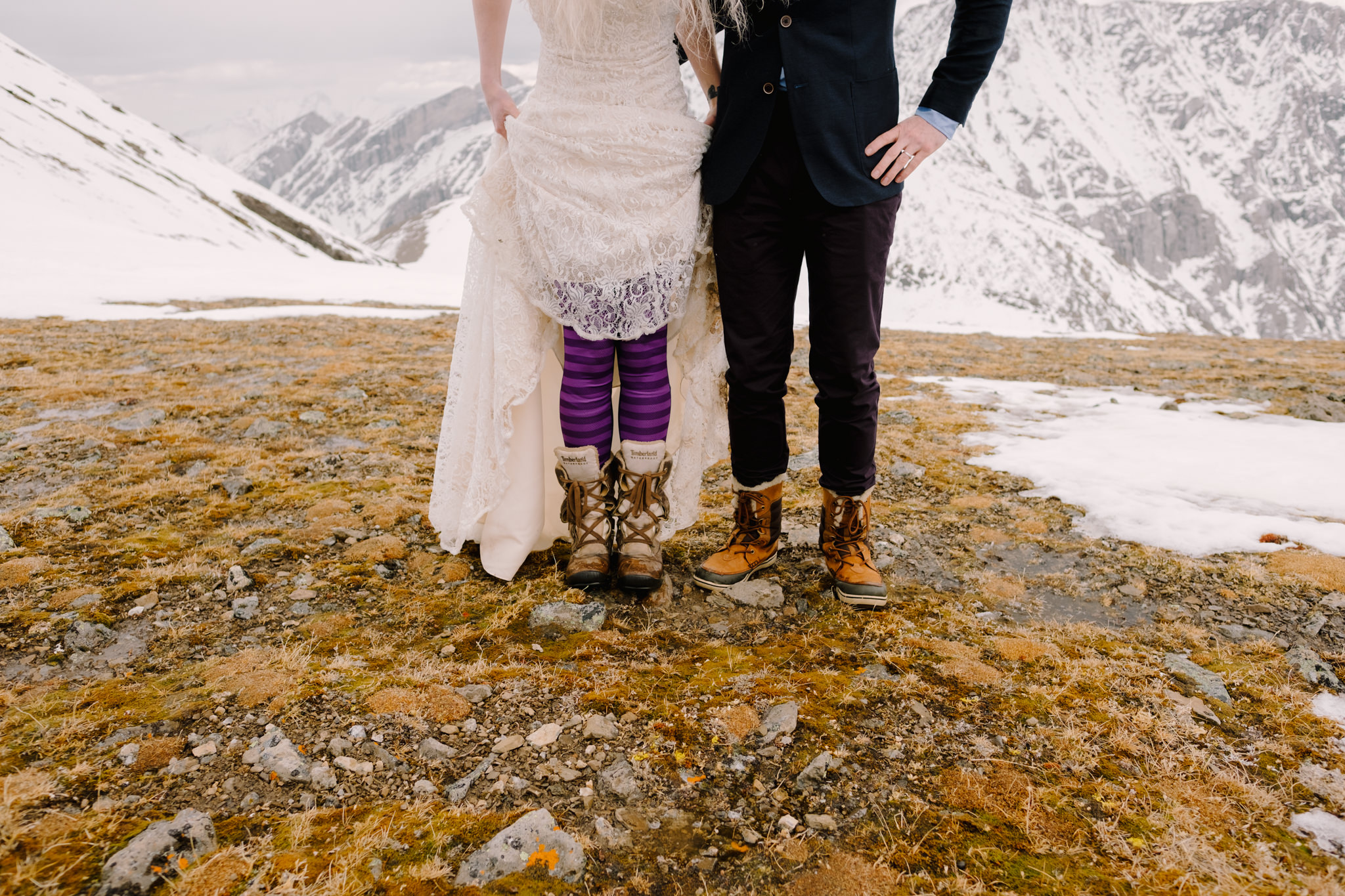 bride and groom wearing hiking boots
