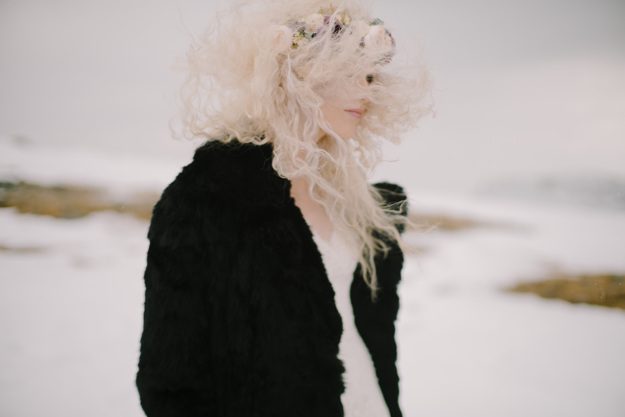 Bride wearing black fur coat