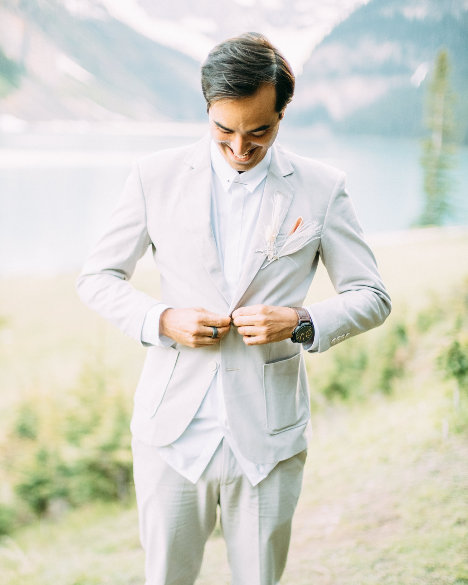 groom wearing gray suit and no tie